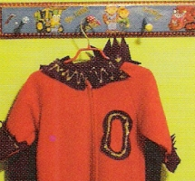 photo of child's clothing on hook to illustrate kids' room decorations